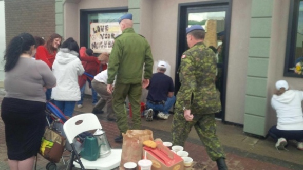 The community turns out en masse in Cold Lake, Alberta, to undo the damage done by vandals to a local Mosque.  Photo Credit:  CTV News